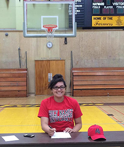 Angela Reid signing with Holy Names